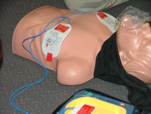 cpr and first aid and AED on a manikin